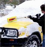 A Man Using The ProEdge Snow Broom To Clean Off His Vehicle